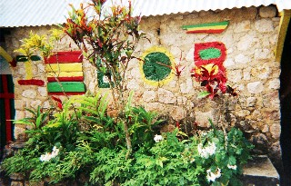 Photo of small room where Bob Marley lived as a child goes here.