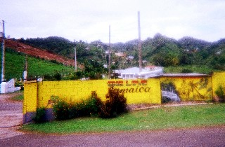 Photo of the compound where we ate on the Bob Marley Bus tour goes here.