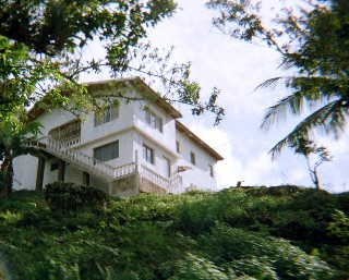 Photo of Jamaica home on a hill goes here.