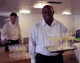 Photo of waiter with champagne goes here.