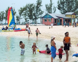 Photo of CocoCay beach with people in the water goes here.