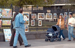 Photo of tourists strolling the art area of the French Quarter goes here.