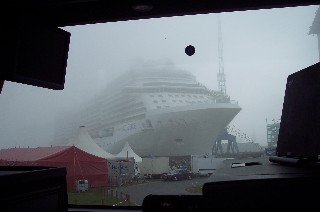 Photo of ship in the early morning fog as we were driving out of the shipyard.