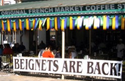 Beignets are Back sign at Cafe du Monde; photo goes here.