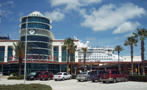 Photo of Disney Cruise Line terminal and Disney Wonder at Port Canaveral goes here.