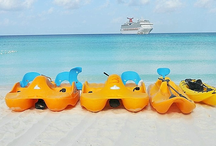 Photo of kayaks awaiting rental at Half Moon Cay; Carnival Splendor is in the background.*
