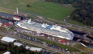 Photo of Coral Princess in the Panama Canal goes here.