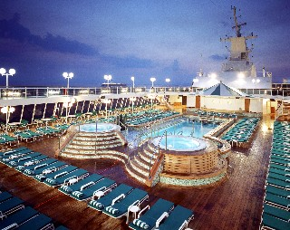 Photo of spacious top deck with pools, lounges and whirlpools goes here.