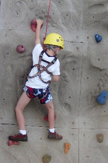 Photo of Aidan on the rock climbing wall goes here.