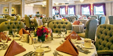 Photo of Queen of the Mississippi dining room goes here.*)