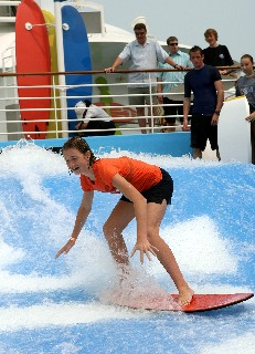 Photo of Flowrider teen surfer goes here.