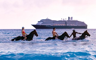 Photo of horseback riders in the surf at Half Moon Cay.
