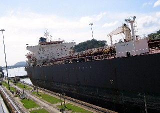 Photo of ship in the Miraflores Locks goes here.