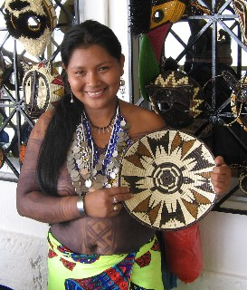 Photo of Indian woman and craft item goes here.