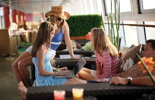 Photo of laptop use onboard NCL goes here; photo courtesy of NCL.