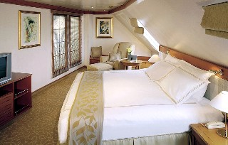 Phot of bedroom area of a Seven Seas Navigator Master Suite goes here.