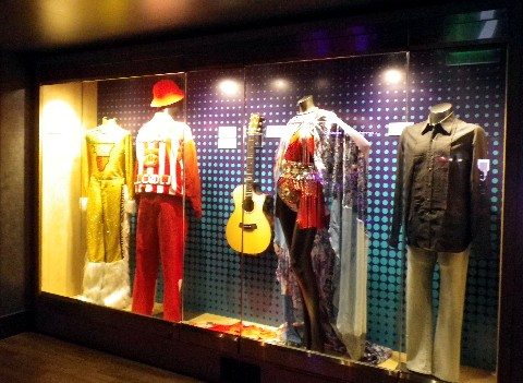 Photo of costumes including a red one from L.L. Cool J goes here.*