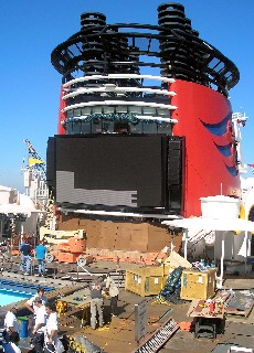 Photo of Disney ship in its drydock, with screen being added.
