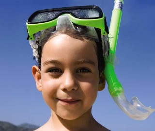 Photo of kid with snorkel mask goes here.