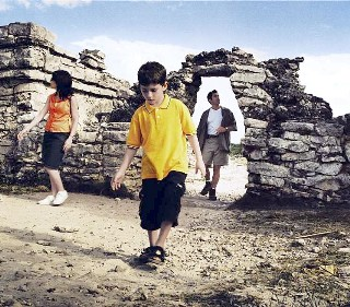 Photo of a family exploring the ruins goes here.