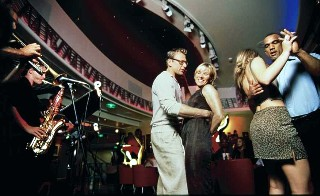 Photo of guests dancing on Royal Caribbean goes here.