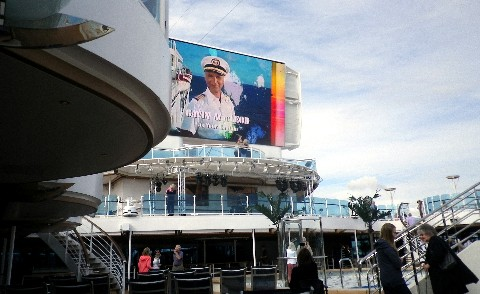 Photo of Gavin MacLeod as Captain Stubing on the big Movies Under the Stars screen onboard Royal Princess.*