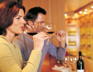 Photo of couple in wine bar goes here.