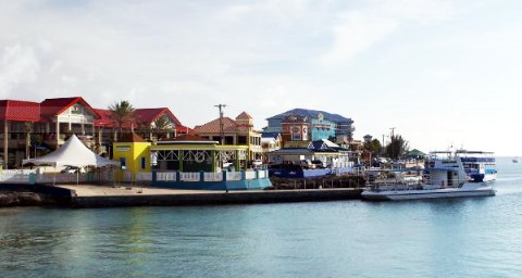 Photo of downtown George Town harborfront goes here.