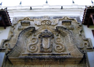 Photo of the Stonework above the doorway of the Inquisition Palace goes here.