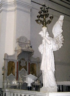 Photo of Cararra marble statue goes here.