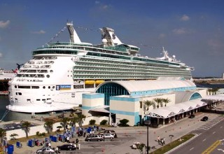 Photo of a Royal Caribbean ship at a Port Canaveral cruise terminal goes here.