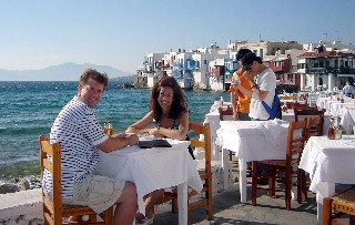 Photo of Veronica and Kyle in a romantic dining spot in Mykonos goes here.