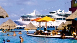 Photo of ship at Costa Maya with Costa Maya's salt water pool in the foreground goes here.