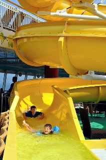 Photo of kids on the water slides on Norwegian Gem goes here.*