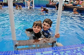Photo of Dinnigan boys in family pool goes here.*