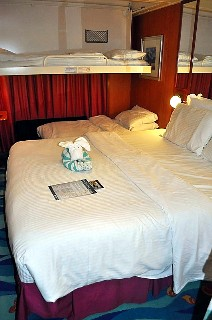 Photo of stateroom made up for four-berth use goes here.*