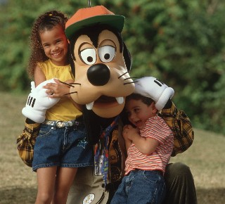Photo of Pluto with two children at Disney World goes here.