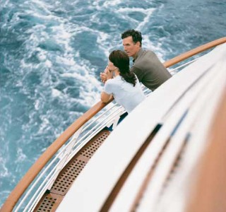 Photo of Couple on Balcony of ship goes here.