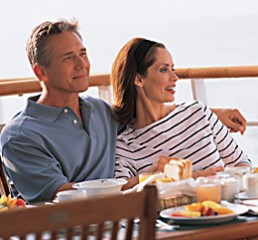 Couples relaxes on deck prior to a day of shopping with a Personal Shopper.
